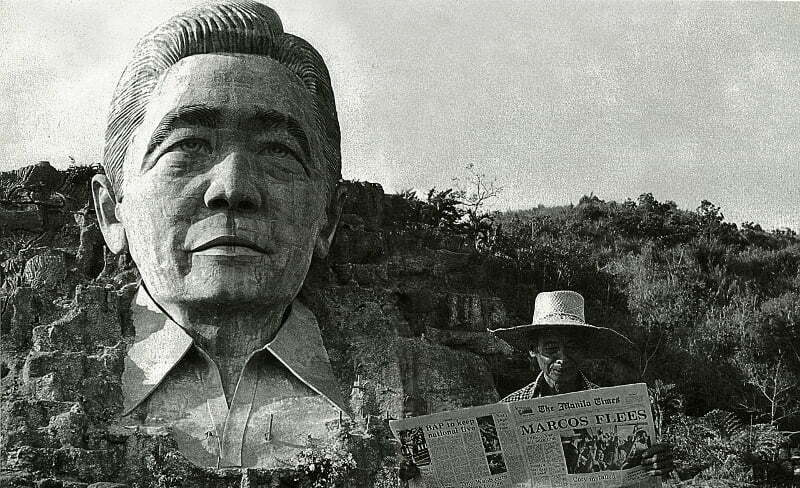 "A farmer in Agoo, La Union, standing in front of the Marcos monument, reads about it the following day in a newspaper carrying the headlines ""Marcos Flees."""