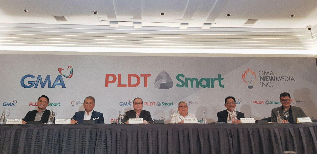 PLDT SVP and Head of Consumer Business–Market Development Oscar Enrico A. Reyes, PLDT EVP and Chief Revenue Officer Ernesto R. Alberto, PLDT and Smart Chairman and CEO Manuel V. Pangilinan, GMA Network Chairman and CEO Felipe L. Gozon, GMA Network President and COO Gilberto R. Duavit, Jr., and NMI President and COO Judd Gallares during the signing ceremony of the GMA-PLDT partnership in Makati City on January 9, 2019.
